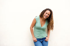 Attractive young woman laughing against white background Royalty Free Stock Photos