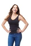Attractive young woman laughing with hands on hips Stock Photo
