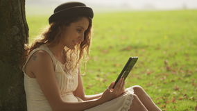 Attractive young woman laughing on her tablet device Royalty Free Stock Photos
