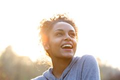 Attractive young woman laughing and looking up Stock Images