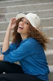 Attractive young woman laughing outdoors Royalty Free Stock Photo