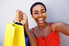 Attractive young woman laughing with shopping bags Royalty Free Stock Photos