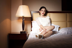 Attractive young woman on bedroom. Attractive young woman laying on bedroom in hotel Stock Image