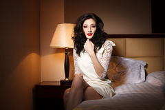 Attractive young woman on bedroom. Attractive young woman laying on bedroom in hotel Royalty Free Stock Photo