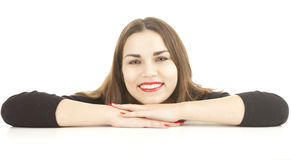 Attractive young woman leaning on the white table Stock Image