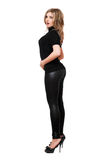 Attractive young woman in leggings. Isolated Stock Image