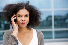 Attractive young woman listening to cellphone Royalty Free Stock Image