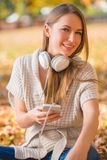 Attractive young woman listening to music Stock Photo