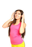 Attractive young woman listening to music on a white background Stock Images
