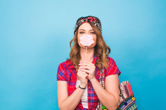Attractive young woman with lollipop in hand on blue background with copy space Royalty Free Stock Photos