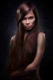 Attractive young woman with long hair Royalty Free Stock Images