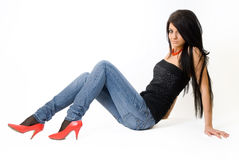 Attractive young woman with long hair on floor Royalty Free Stock Image
