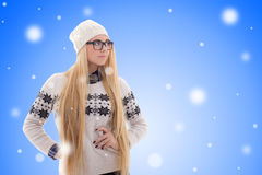 Attractive young woman with long hair in warm winter clothes ove Royalty Free Stock Photography