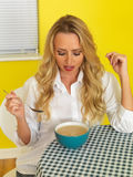 Attractive Young Woman looking at Bowl of Soup Stock Photography