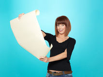 Attractive young woman looking at a drawing Stock Photos