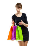Attractive young woman looking into paper bags Stock Images