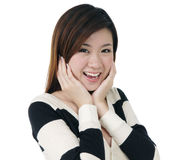 Attractive young woman looking surprised Stock Photos