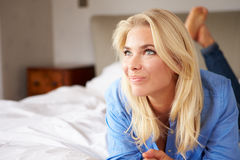 Attractive Young Woman Lying On Bed Royalty Free Stock Photo