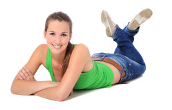 Attractive young woman lying on the floor Stock Photography