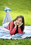Attractive young woman lying in grass Stock Photography
