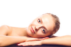 Attractive young woman lying on her hands Royalty Free Stock Images