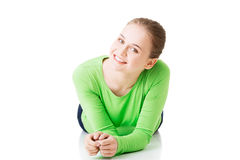 Attractive young woman lying and looking into camera. Royalty Free Stock Image