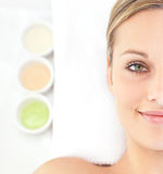 Attractive young woman lying on a massage table Stock Photography
