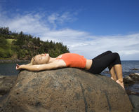 Free Attractive Young Woman Lying On Rock At Beach Royalty Free Stock Images - 12752959