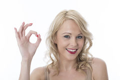Attractive Young Woman Making OK sign Stock Photo