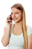 Attractive young woman making a phone call. Attractive young woman making a phone call, isolated on white Royalty Free Stock Photography