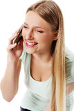 Attractive young woman making a phone call. Attractive young woman making a phone call, isolated on white Stock Photography