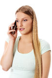 Attractive young woman making a phone call. Attractive young woman making a phone call, isolated on white Stock Images