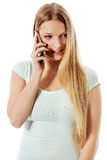 Attractive young woman making a phone call. Attractive young woman making a phone call, isolated on white Royalty Free Stock Image
