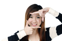 Attractive young woman making a picture frame Stock Photos