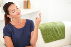 Attractive young woman making a wish Stock Photos