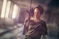 Attractive young woman with marker gun Stock Image
