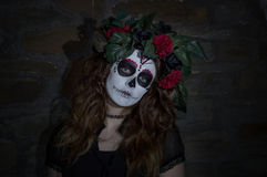 Attractive young woman with Mexican sugar skull makeup royalty free stock photo
