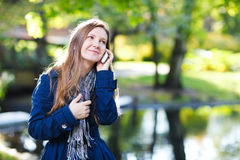 Attractive young woman with mobile phone Stock Photo