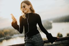Attractive young woman with mobile phone outdoor. Portrait of attractive young woman with mobile phone outdoor Stock Images