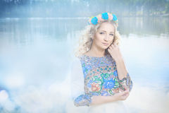 Attractive young woman model near the water. Royalty Free Stock Photo