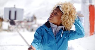 Attractive young woman with a modern afro hairdo stock video footage