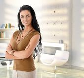 Attractive young woman at modern home. Portrait of attractive young caucasian woman at home, smiling Royalty Free Stock Images