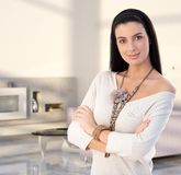 Attractive young woman at modern home Royalty Free Stock Image