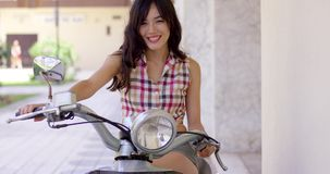 Attractive young woman on a motorbike stock footage