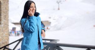 Attractive young woman at a mountain ski resort Royalty Free Stock Photos