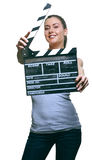 Attractive young woman with movie clapper Stock Photo