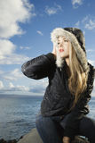 Attractive Young Woman by Ocean Royalty Free Stock Photography