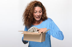 Attractive young woman opening a gift box Royalty Free Stock Photo