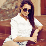 Attractive young woman outdoor portrait Stock Photos