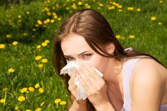 Attractive young woman outdoor with tissue. Outdoor Stock Image